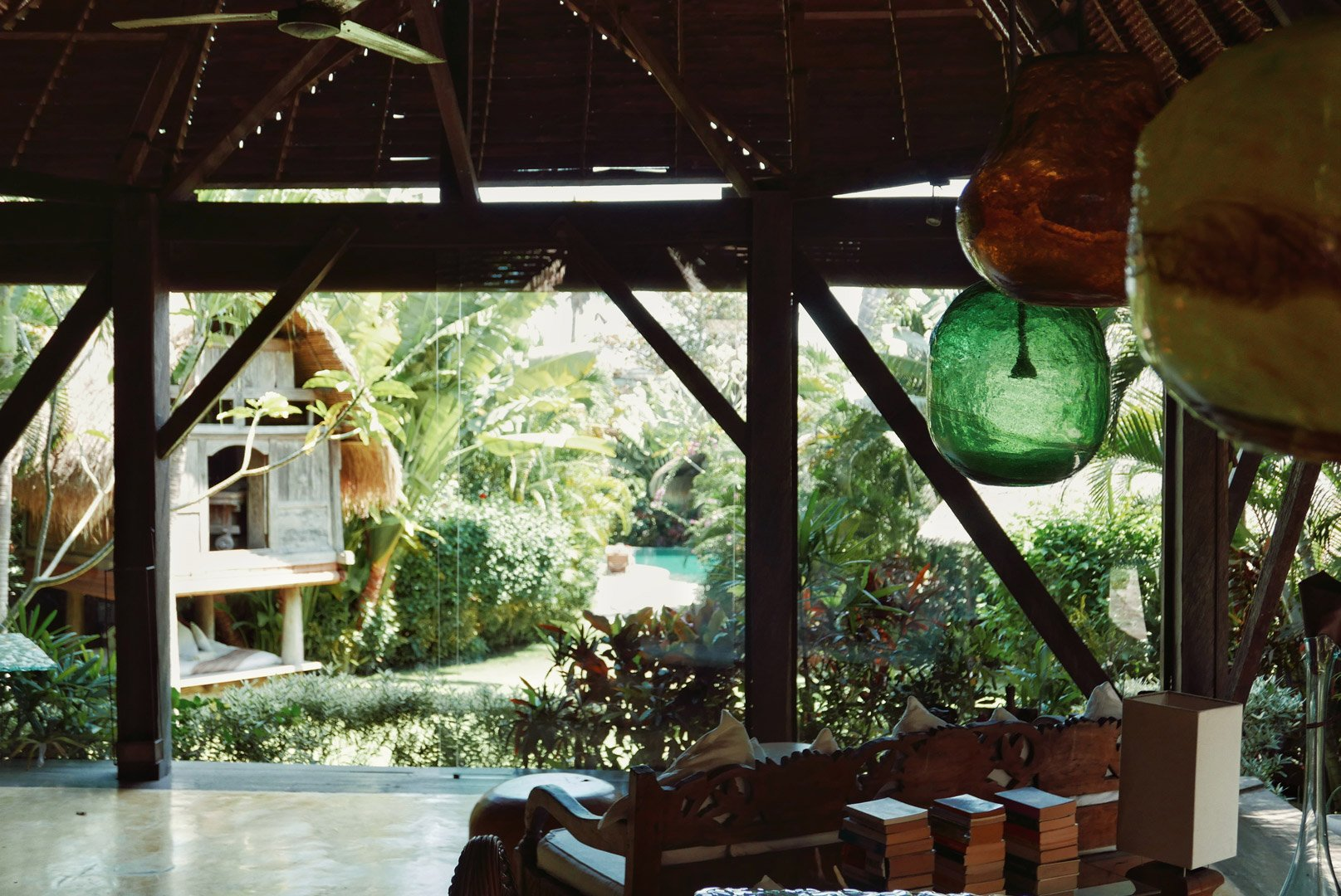 Relaxing view of the eco design open living-dining room of Own Villa surrounded by tropical Bali nature