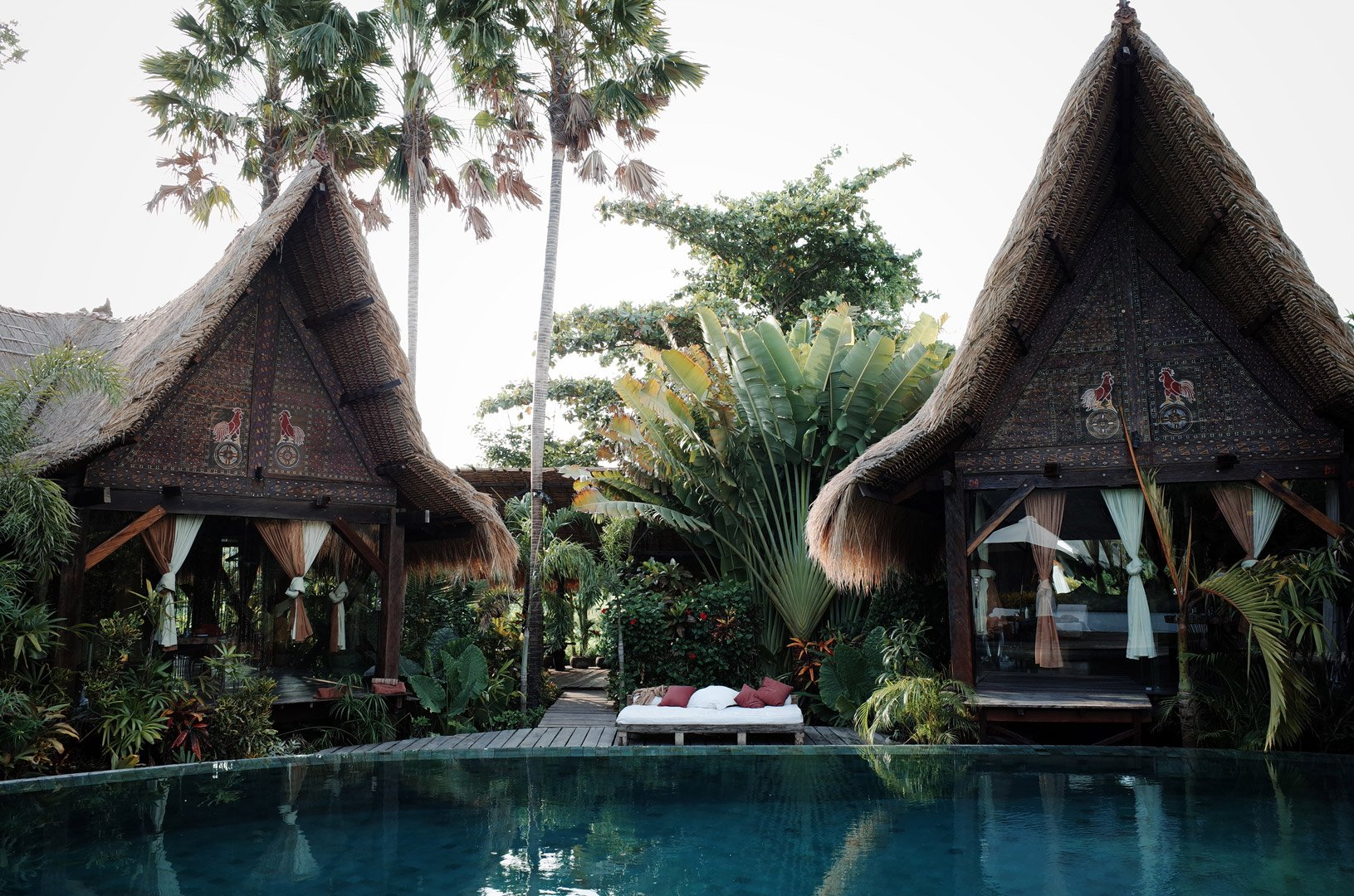 Own Villa poolside eco design bedrooms made of recycled iron wood and facing swimming pool surrounded by tropical Bali nature